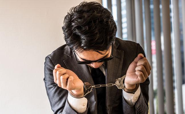 逮捕されるビジネスマン